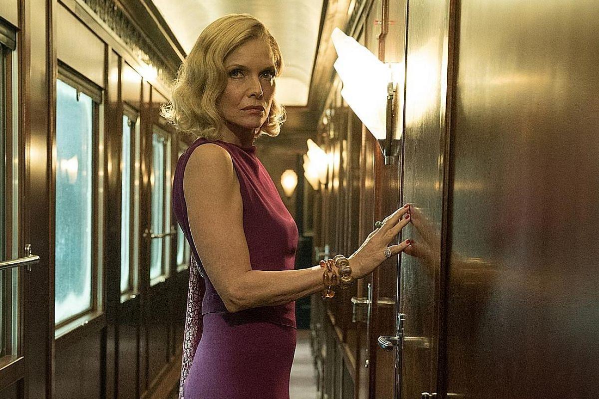 Michelle Pfeiffer plays Caroline Hubbard, a flirtatious American widow with a secret past in Murder On The Orient Express.