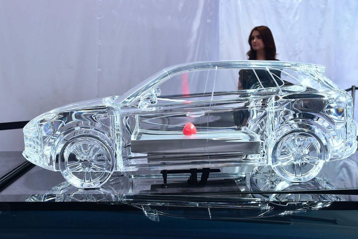 A miniature glass model version of the new Porsche Cayenne on display at the 2017 LA Auto Show on November 29, 2017 in Los Angeles, California, on the second of 3 press days before the event opens to the public from December 1-10, 2017. PHOTO: AFP