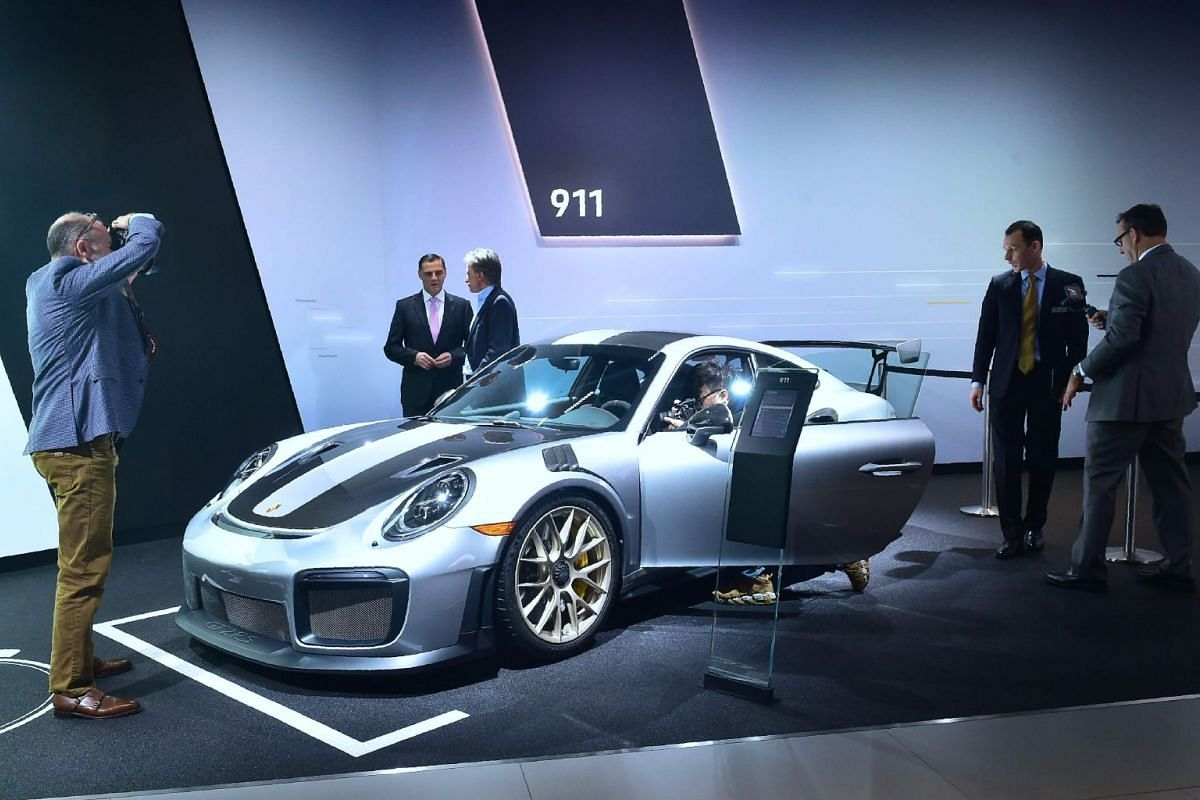 Attendees to the AutoMobility LA trade show taking a look at the new Porsche 911 GT2-RS on Nov 29, 2017.
