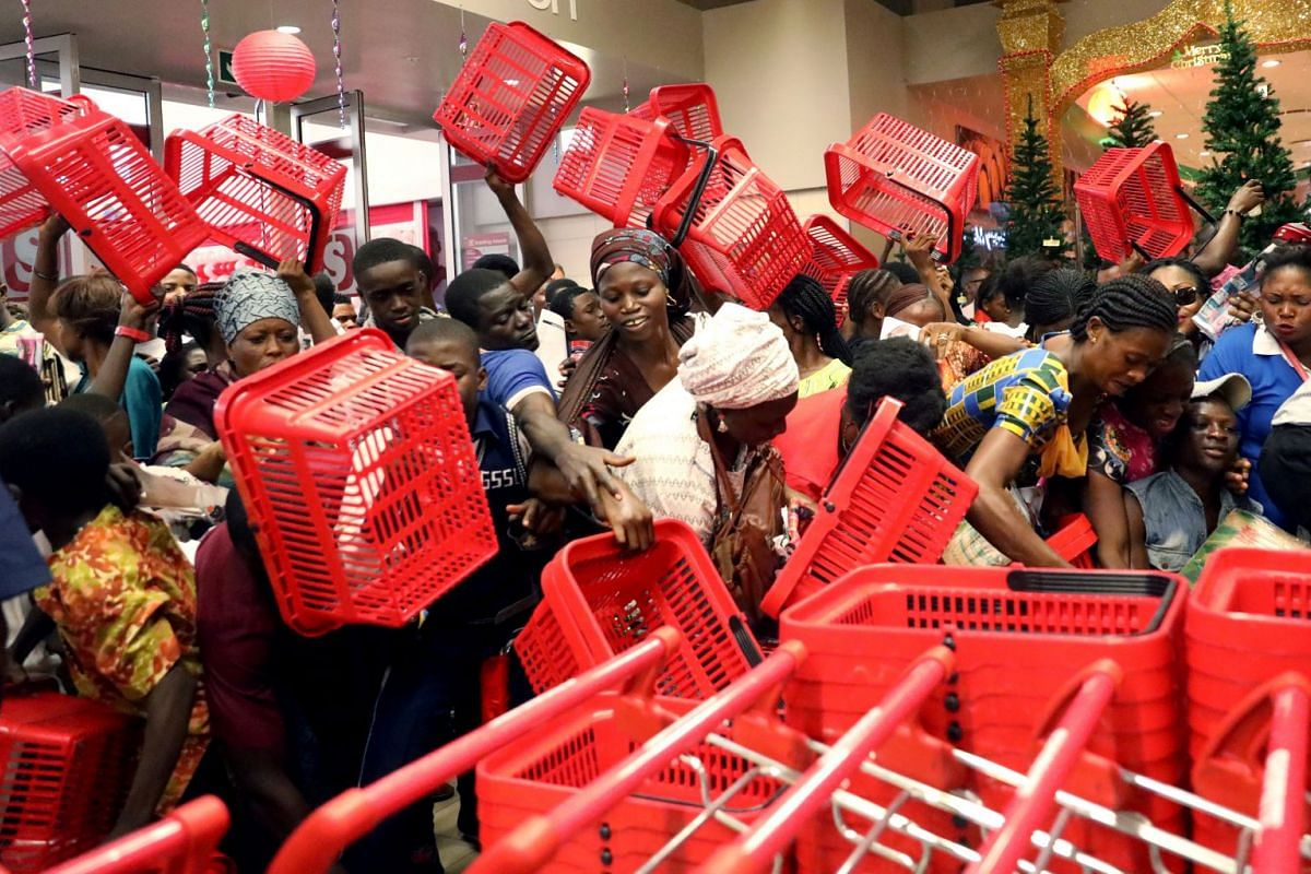 People reached out to pick baskets at a newly commissioned Shoprite store at Novare Gateway mall Abuja, Nigeria on Nov 30, 2017. PHOTO: REUTERS