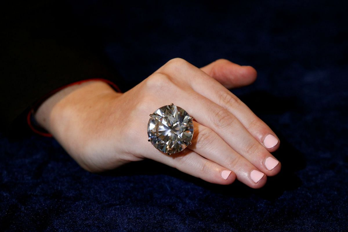 A model wears a 110-carat circular diamond during a media preview for the 'Magnificent Jewels and Fine Jewels' auction at Sotheby's in New York, US on Nov 30, 2017. PHOTO: REUTERS