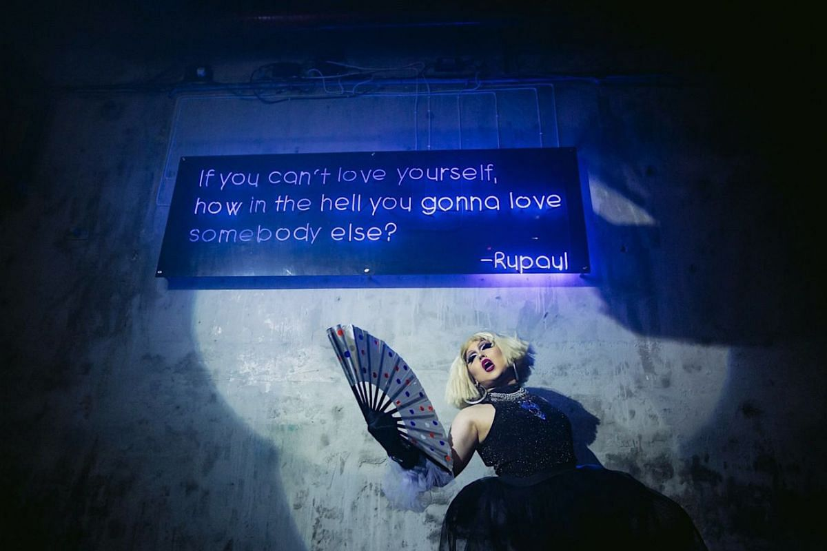 "Peaches: A quote by iconic drag queen Rupaul Charles - ""If you can't love yourself, how in the hell you gonna love somebody else?"" - is emblazoned in neon lights (above) over the dance floor at Peaches."