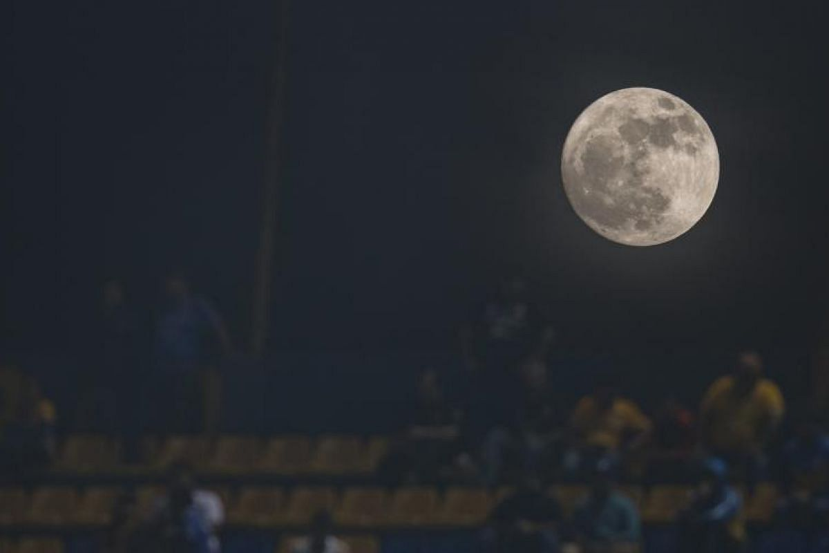 The supermoon seen from the University Stadium in the city of Monterrey, Mexico.