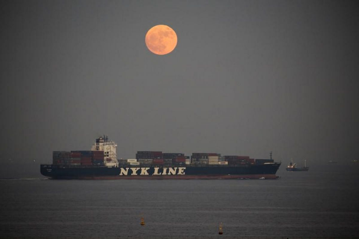 The supermoon rising over the Tokyo Bay, in Japan.