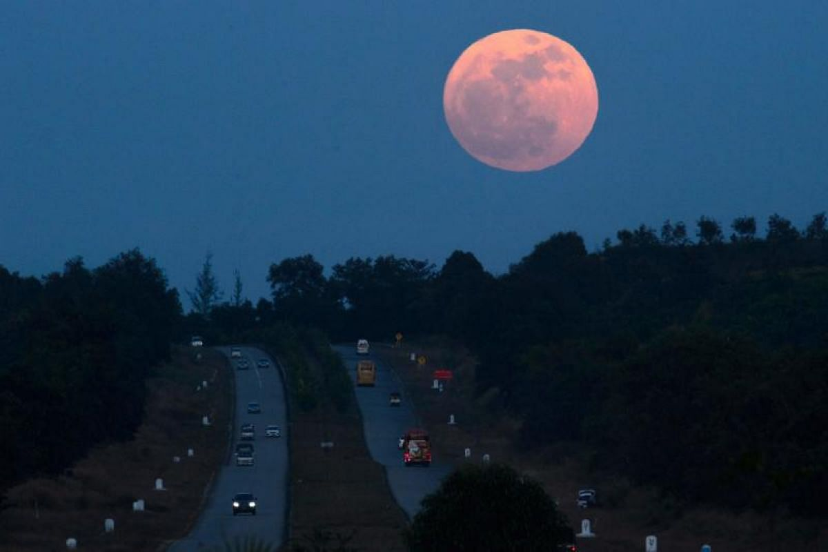 The supermoon rises over a highway near Yangon.