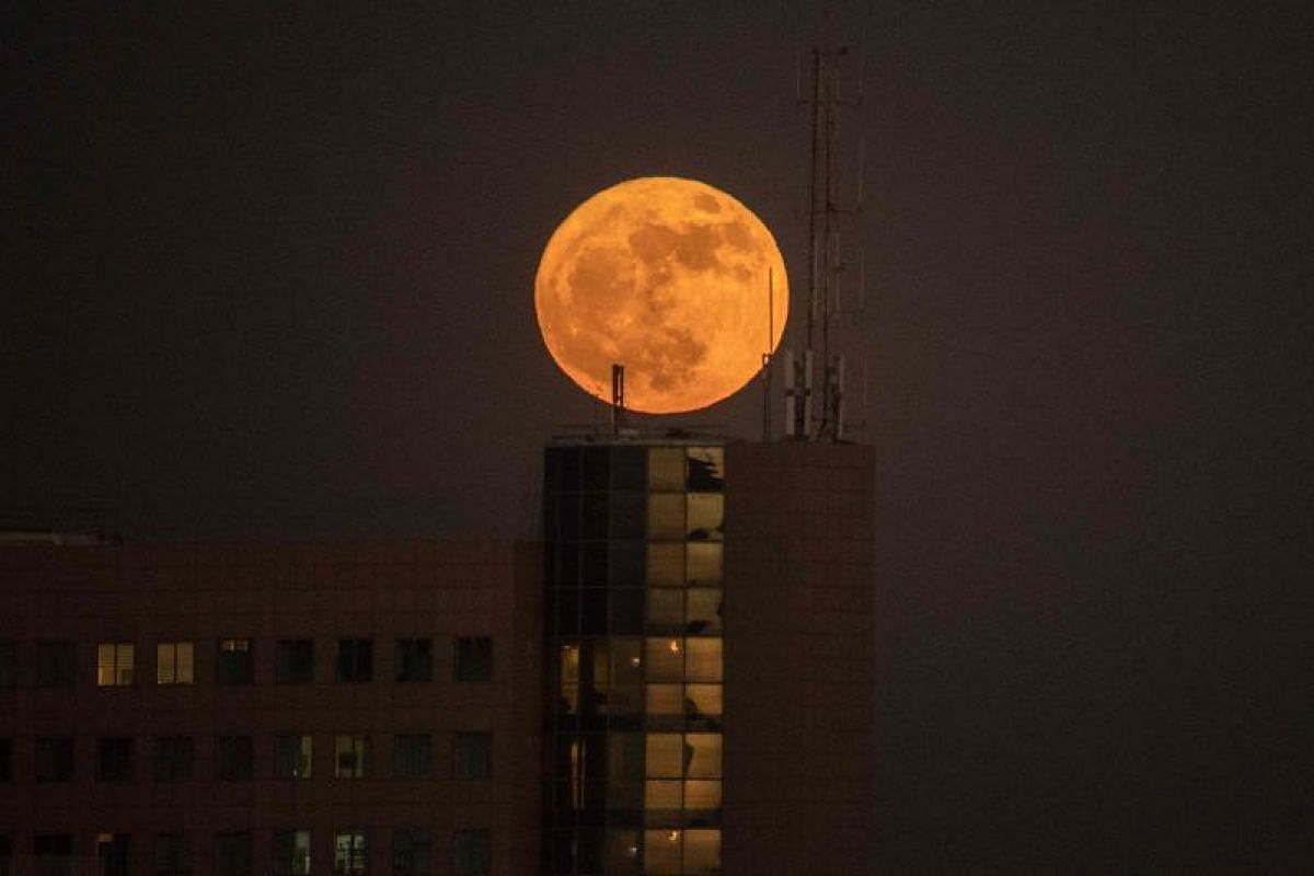 The supermoon over a building in Netanya, Israel.