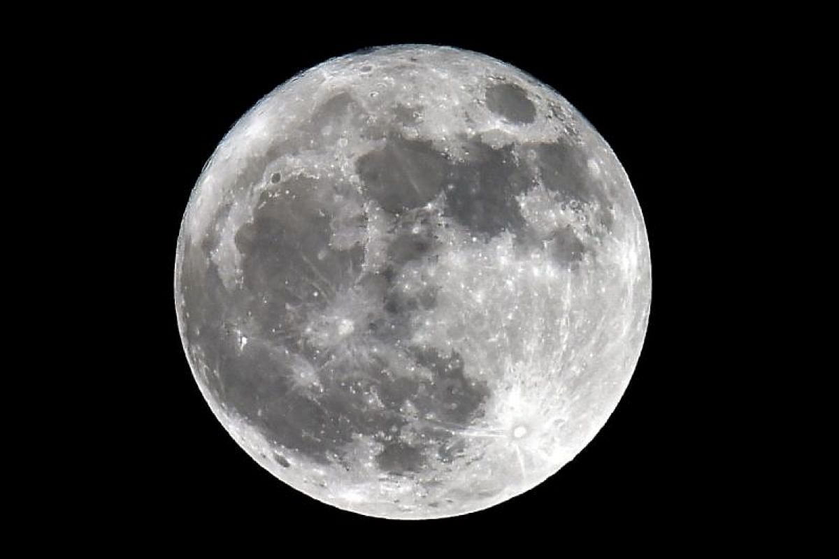 The supermoon seen from Trebons-sur-la-Grasse, southern France.