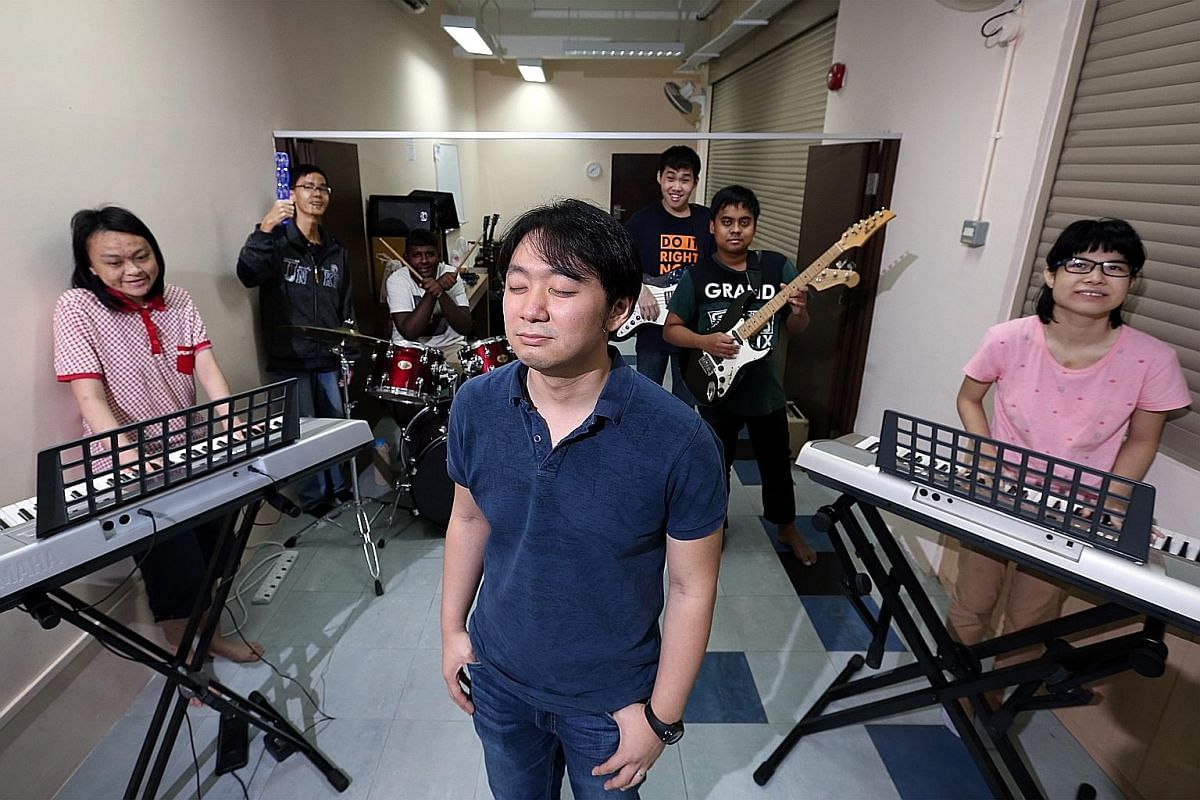 Mr Ken Wong, who started losing his vision at the age of nine due to macular dystrophy, teaches music at Faith Music Centre to children, adults, senior citizens and people with disabilities.