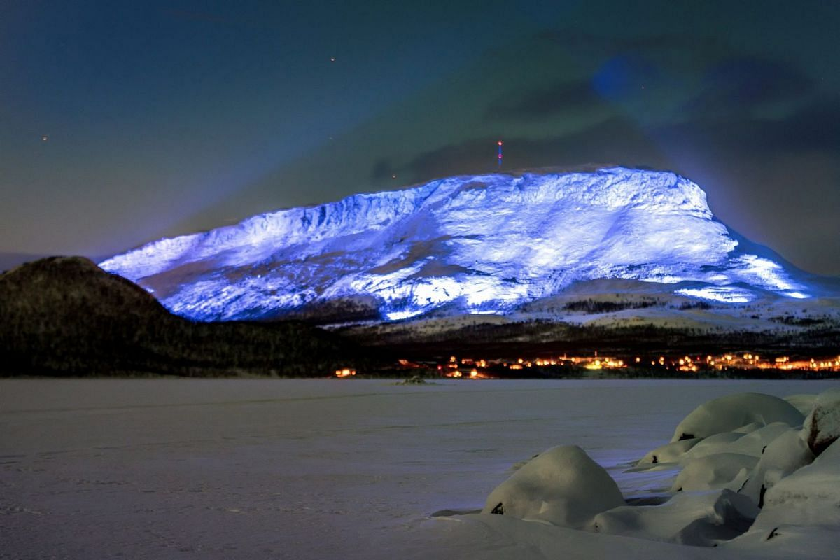 The Saana fell is lighted as part of the Luminous Finland 100 project, a light art event that will be held in honour of the 100th anniversary of Finland's independence, in Kilpisjarvi, Finland December 4, 2017. PHOTO: LEHTIKUVA VIA REUTERS