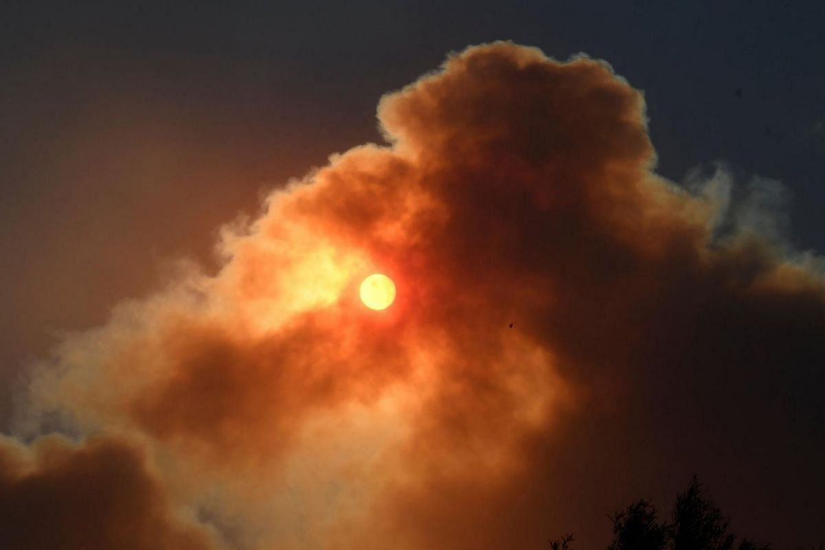 The morning sun blocked by the thick smoke from an early-morning creek fire.