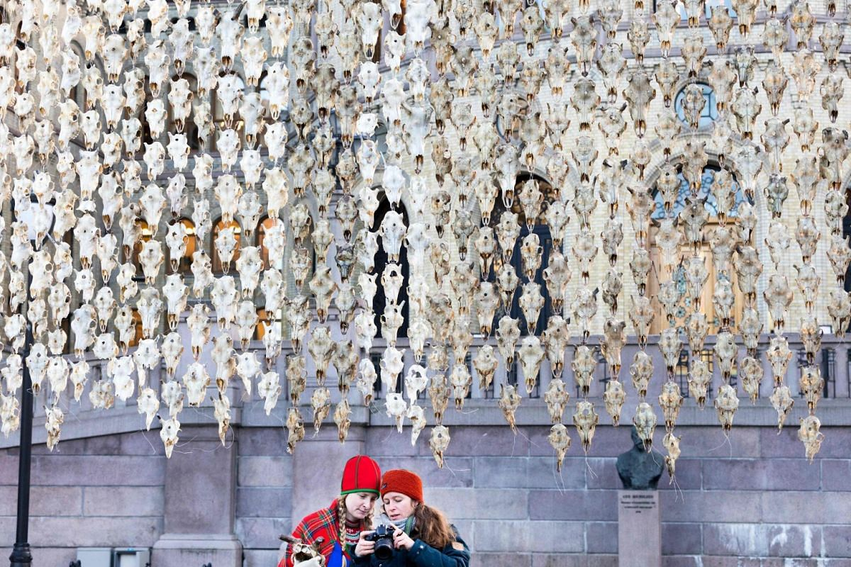 An art installation by Norwegian-Sami artist Maret Anne Sara made of 400 reindeer scalps is hanging in front of the Parliament building in Oslo, Norway, on Dec 5, 2017. PHOTO: NTB SCANPIX VIA AFP