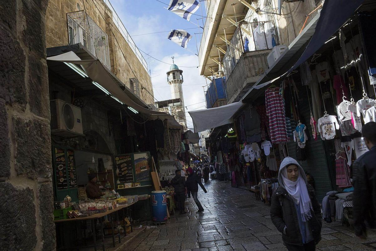 A Palestinian youth walks in the Old City of Jerusalem, on Dec 6, 2017.