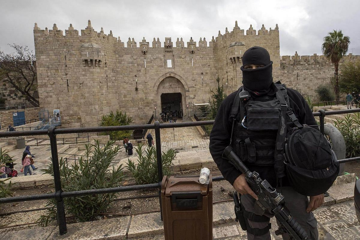An Israeli policeman stands guard at Damascus gate of the Old City of Jerusalem, on Dec 6, 2017.