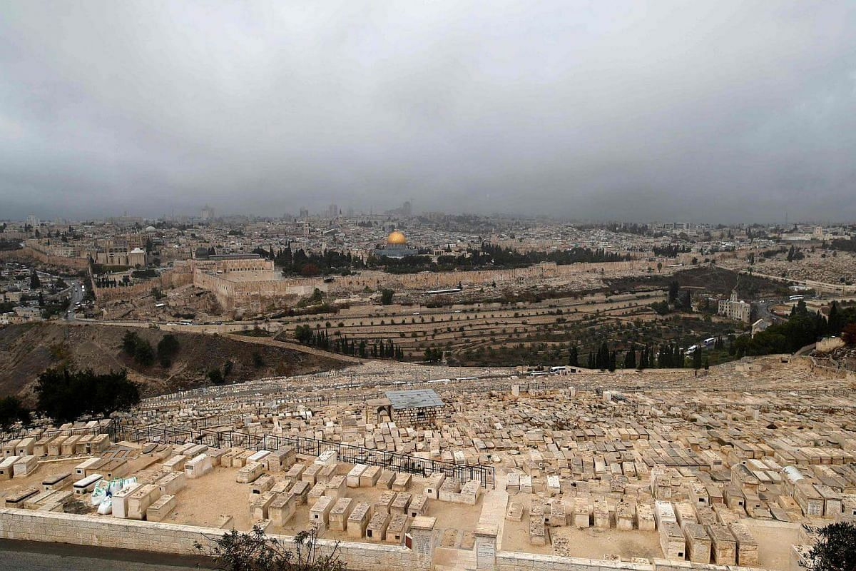 A Jewish cemetary and the Old City of Jerusalem with the Dome of the Rock mosque in the centre, on Dec 6, 2017.