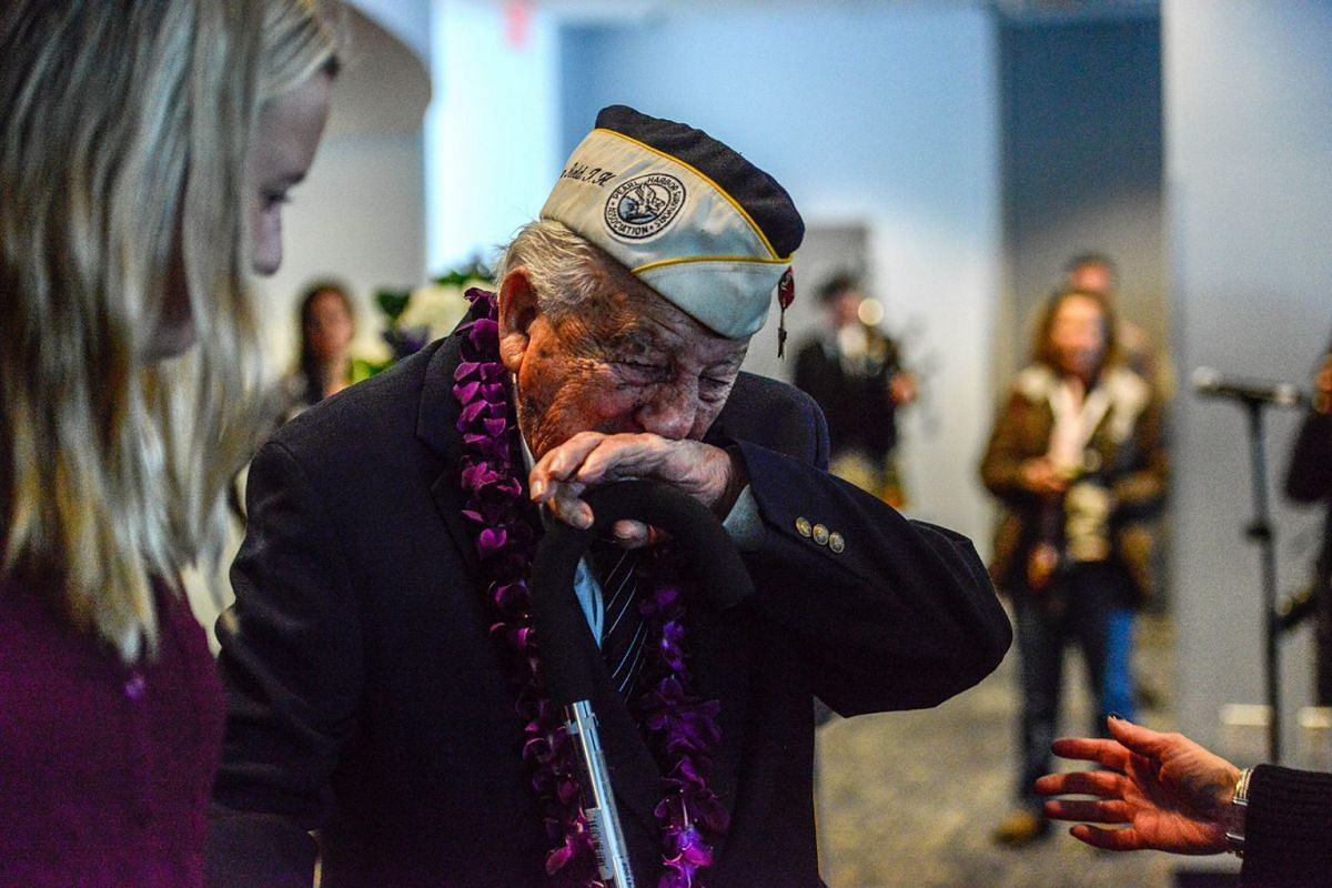 """Armando """"Chick"""" Galella gets emotional during a wreath-laying ceremony aboard the Intrepid Sea, Air and Space Museum the on Dec 7, 2017 in New York City. The 96-year-old Galella was the only survivor to attend the ceremony commemorating the 76th anni"""