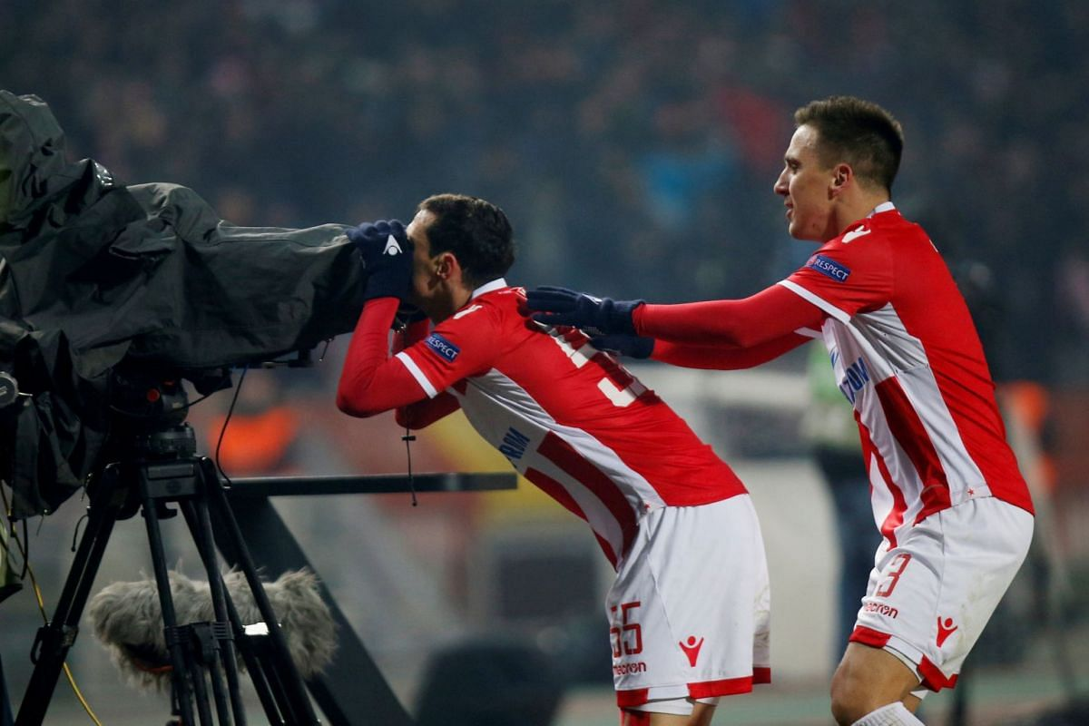 Red Star Belgrade's Slavoljub Srnic celebrates scoring their first goal with Branko Jovicic at the Red Star Belgrade vs FC Cologne Europa League football game held at the Rajko Mitic Stadium in Belgrade, Serbia on Dec 7, 2017. PHOTO:  REUTERS