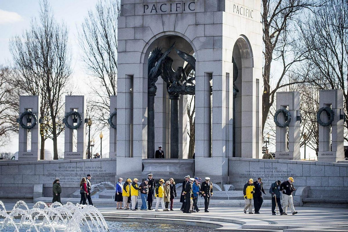National Park Service volunteers escort WWII veterans to the wreath laying ceremony held by the Friends of the National World War II Memorial and the National Park Service to commemorate Pearl Harbor Remembrance Day in Washington, on Dec 7, 2017.