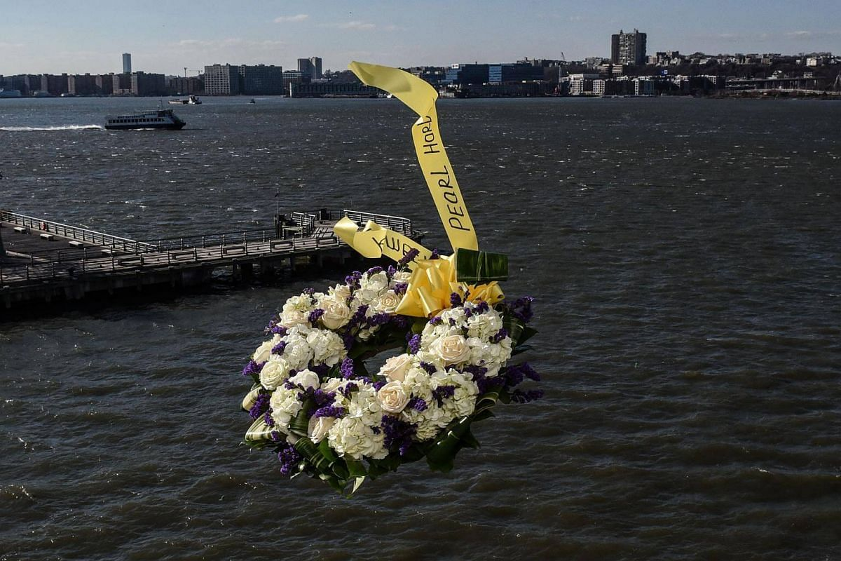 Armando 'Chick' Galella (not pictured) throws a wreath at a wreath-laying ceremony aboard the Intrepid Sea, Air and Space Museum in New York City, on Dec 7, 2017.