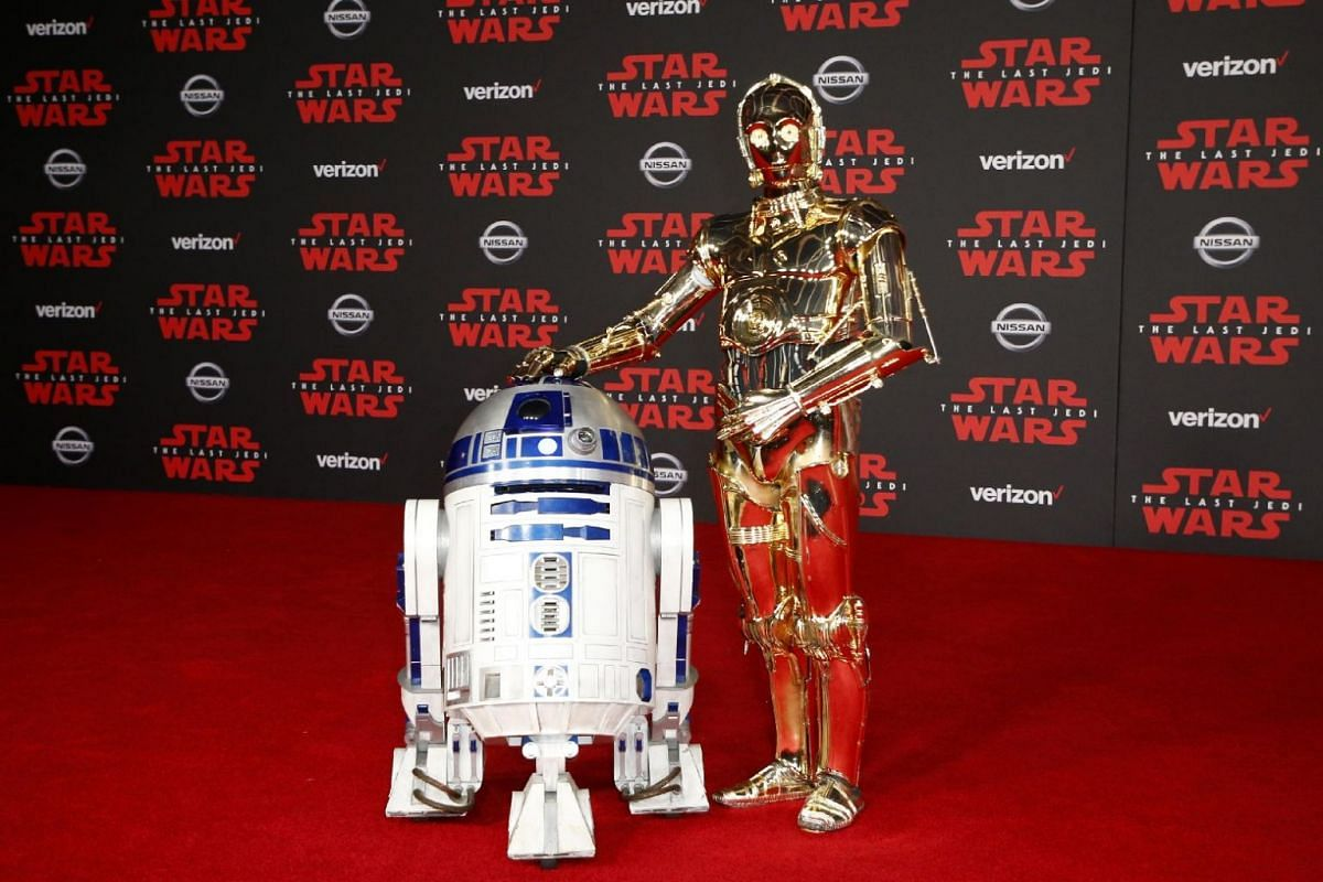 R2-D2 (left) and C-3PO walk the red carpet at the world premiere of Star Wars: The Last Jedi.