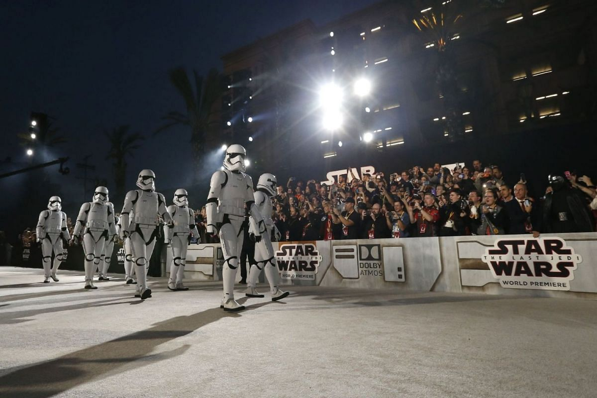Storm Troopers walk in front of fans at the world premiere of Star Wars: The Last Jedi on Dec 10, 2017.