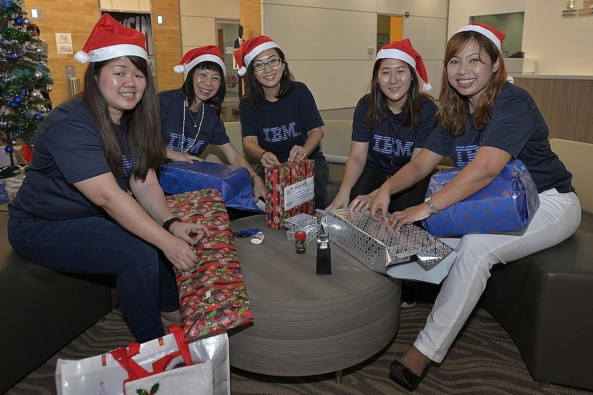 IBM Singapore staff (from far left) Hedy Lee, Lim Bee Lay, Fennie Foong, Lee Xin Yi and Elis Dawati are part of a group that is volunteering for Christmas this year.