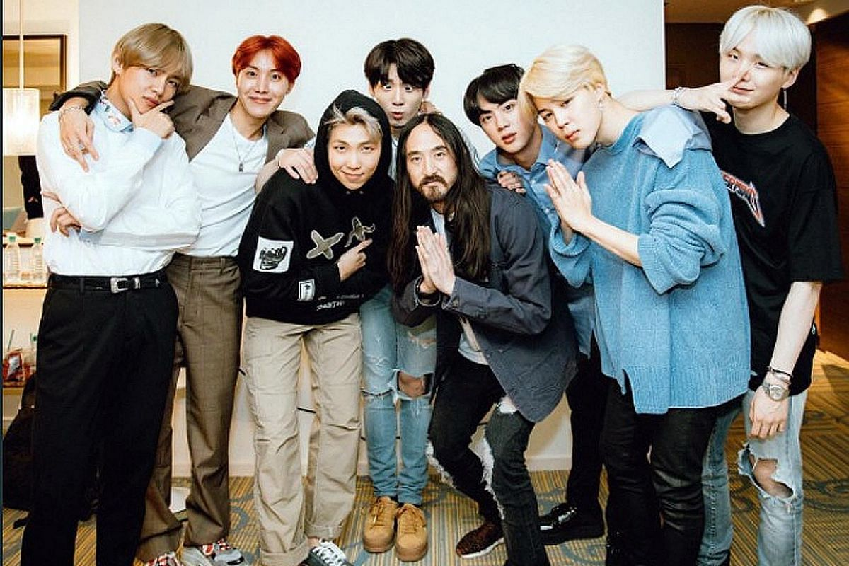 BTS with DJ Steve Aoki (fifth from left).