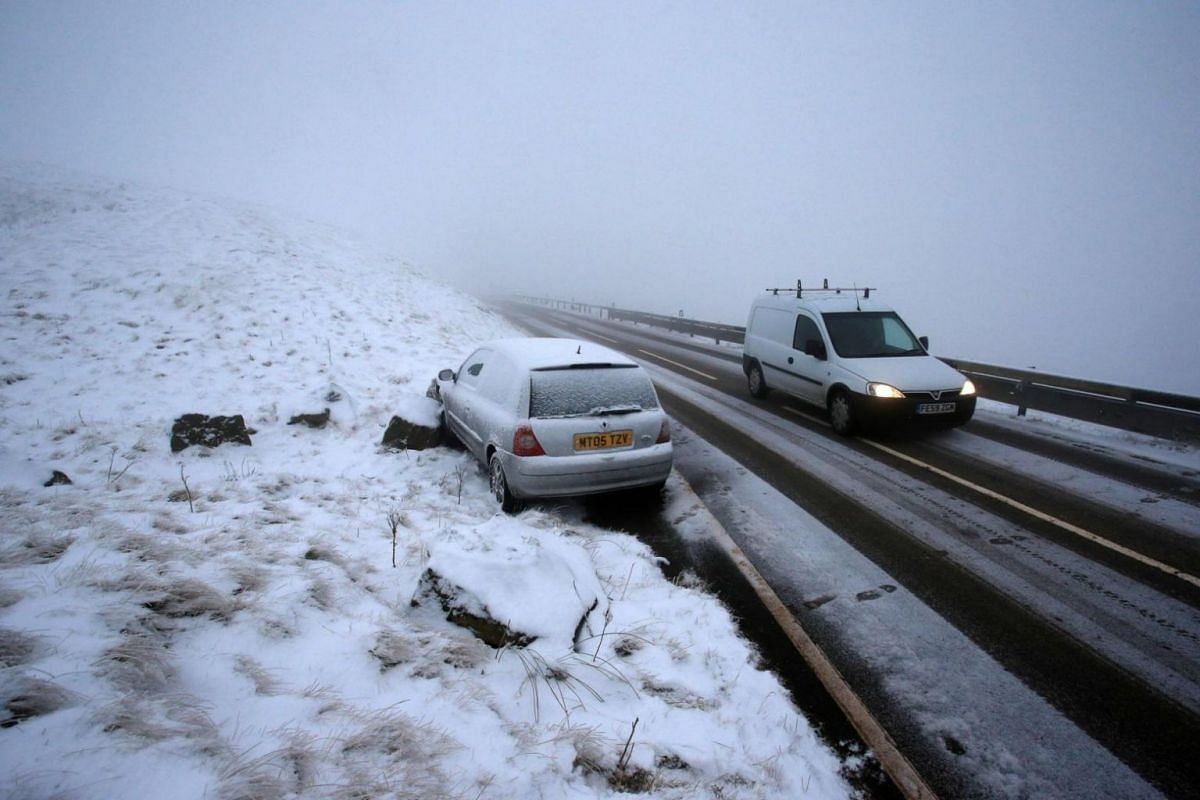 An abandoned car is parked along the road after skidding into a rock on one of the rural roads in Derbyshire, northern England.