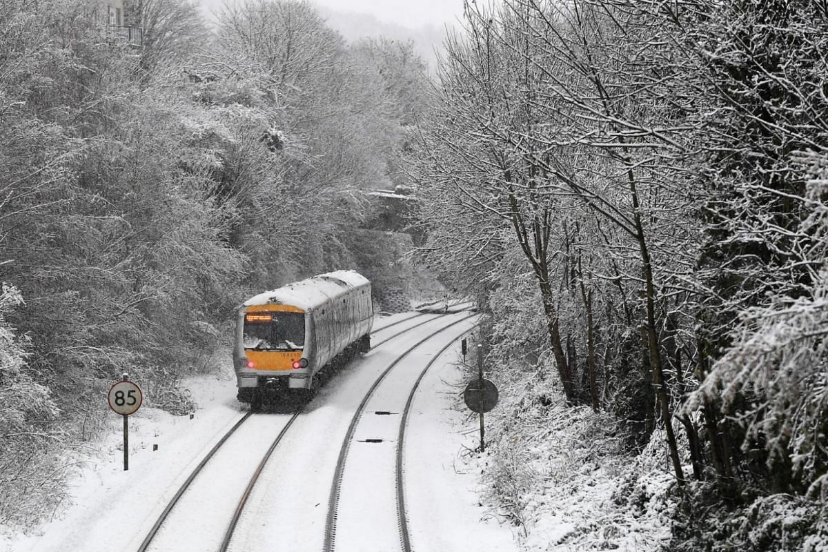 A train travels along the snow-covered tracks in High Wycombe, 48km northwest of London.