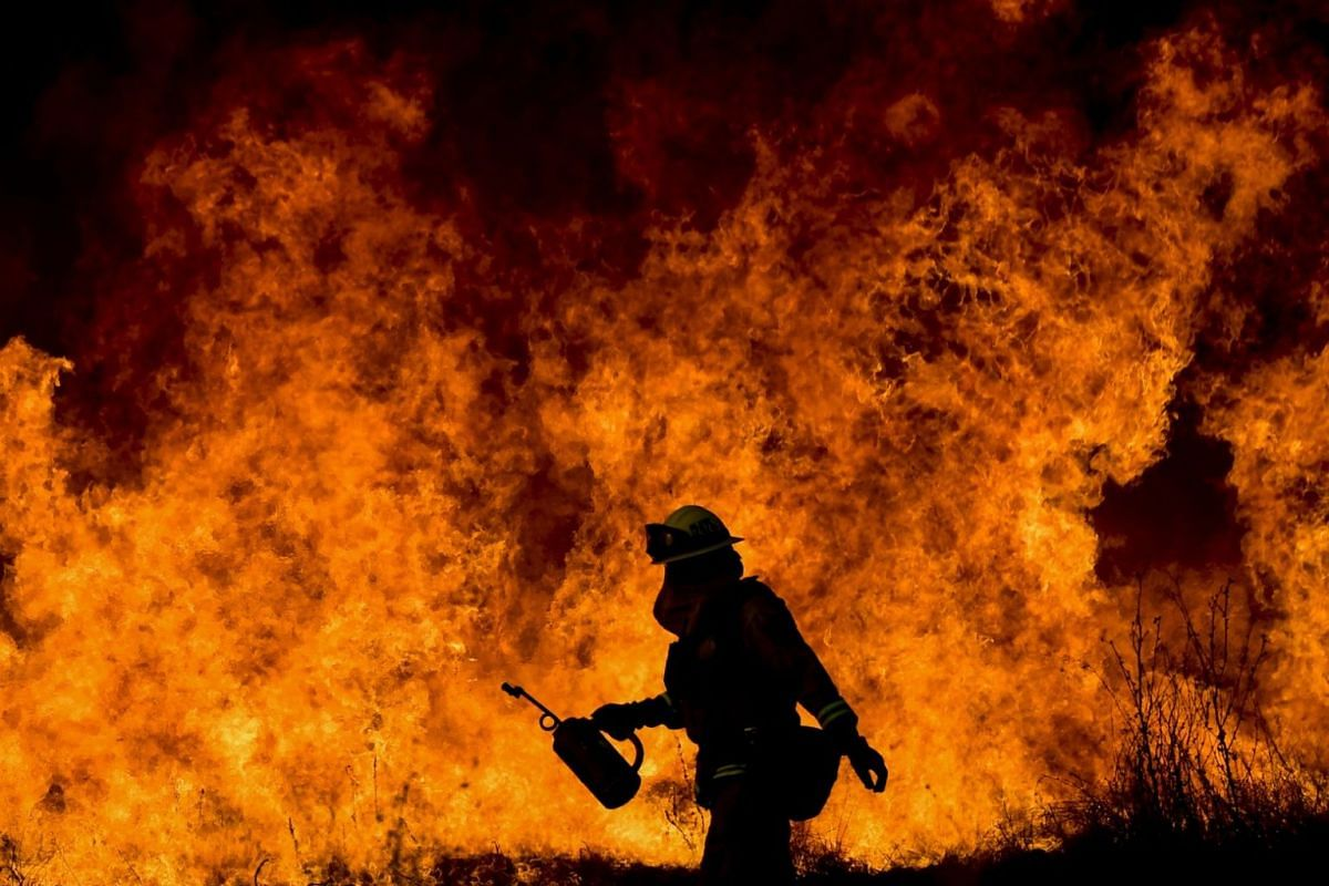A firefighter works in Ventura County as efforts continue against the Thomas Fire in Ojai, California, on Dec 9, 2017.