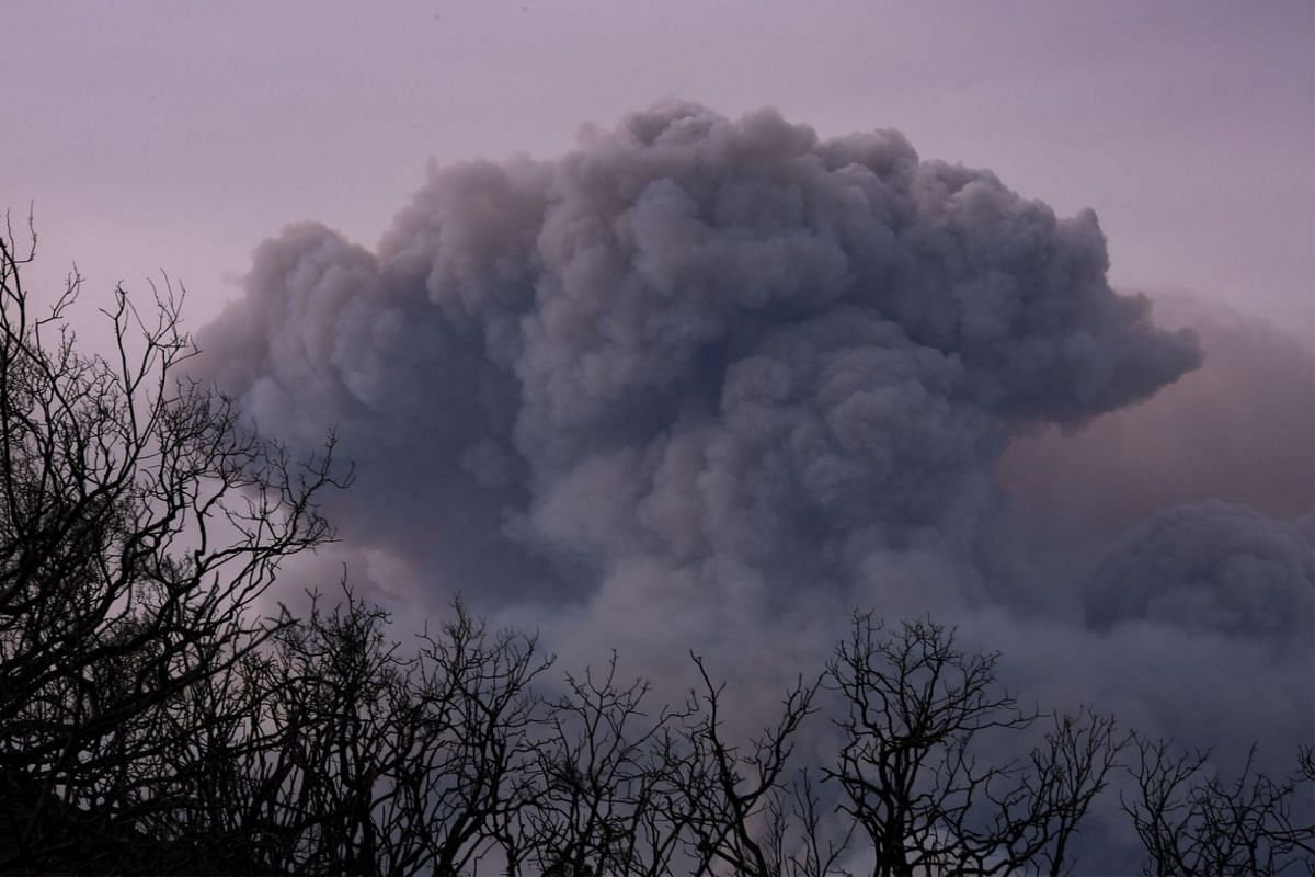 A plume of smoke is seen from Ojai, California as the Thomas Fire grows and advances toward seaside communities near Carpinteria, California, on Dec 10, 2017.