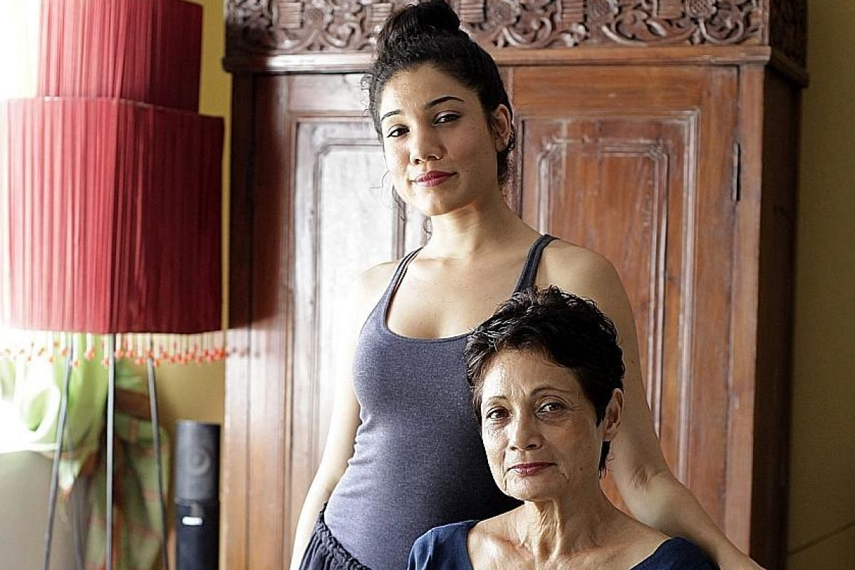 Mother-daughter duo Ajuntha Anwari (seated) and Sharda Harrison are performing in Hayat.