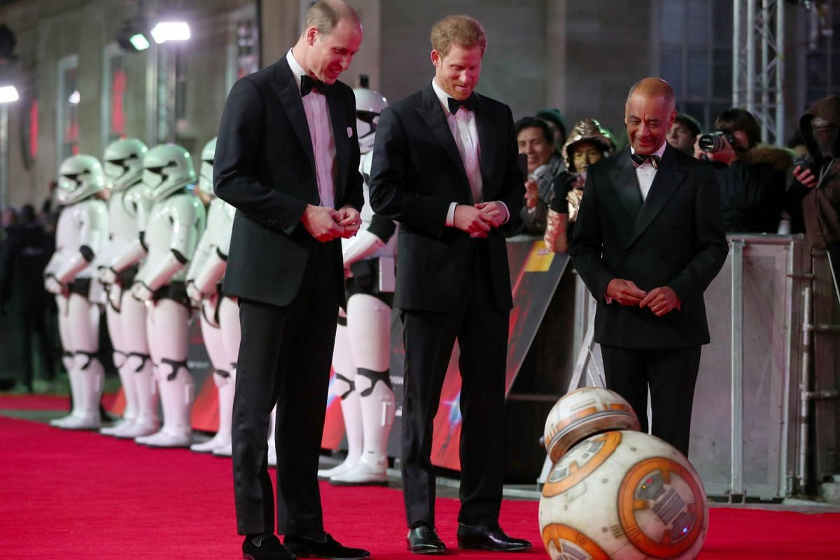 Prince William (left) and Prince Harry (centre) are greeted by droid BB-8.