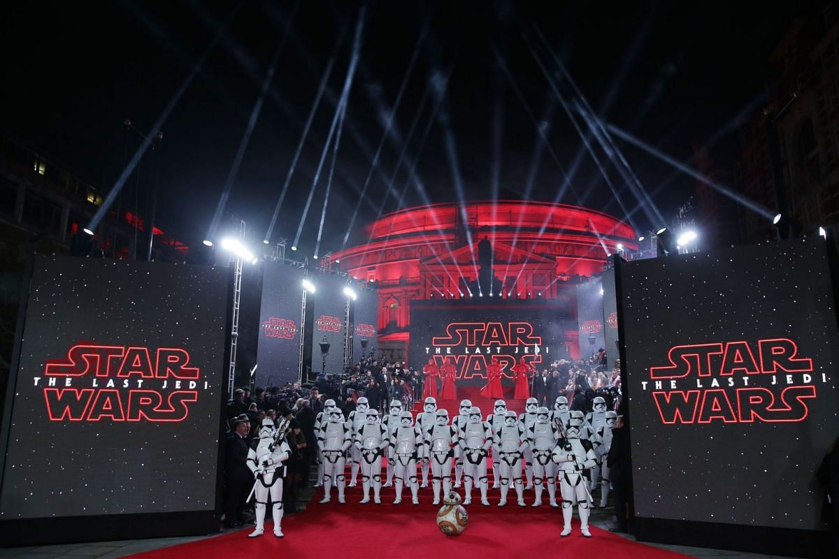 Stormtroopers and robot BB-9E posing on the red carpet for the European premiere of the movie in London.