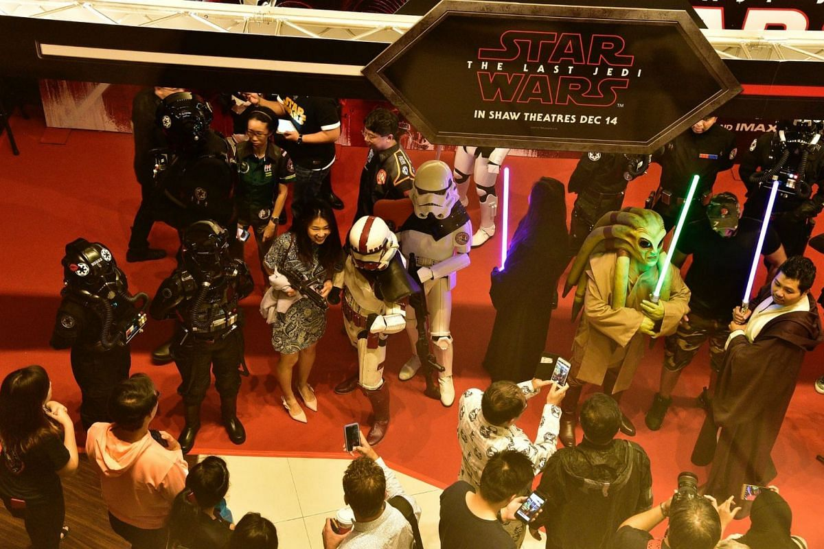 Movie-goers taking a photo with members of the 501st Legion.