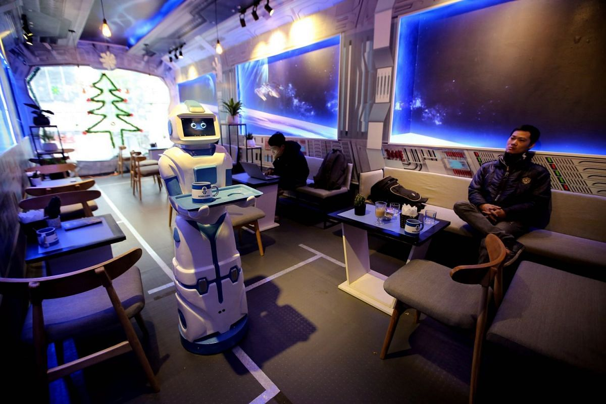A robot serves drink to the tables in a coffee shop in Hanoi, Vietnam, December 14, 2017. The robot named Morta, 130 cm in height and 20 kilograms in weight and worth nearly 9000 US dollar, is considered as the first robot that serves in a coffee sho