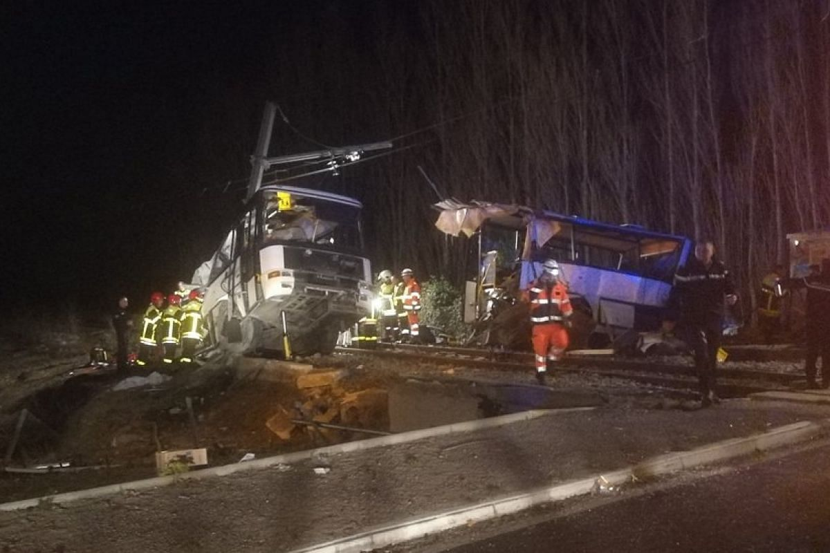 Emergency personnel at the crash site of a school bus with a train near Millas and Saint-Feliu-d'Amont, Southern France, Dec 14, 2017. Four children have been killed and at least 19 people are 'seriously injured' after the school bus was 'cut in two'