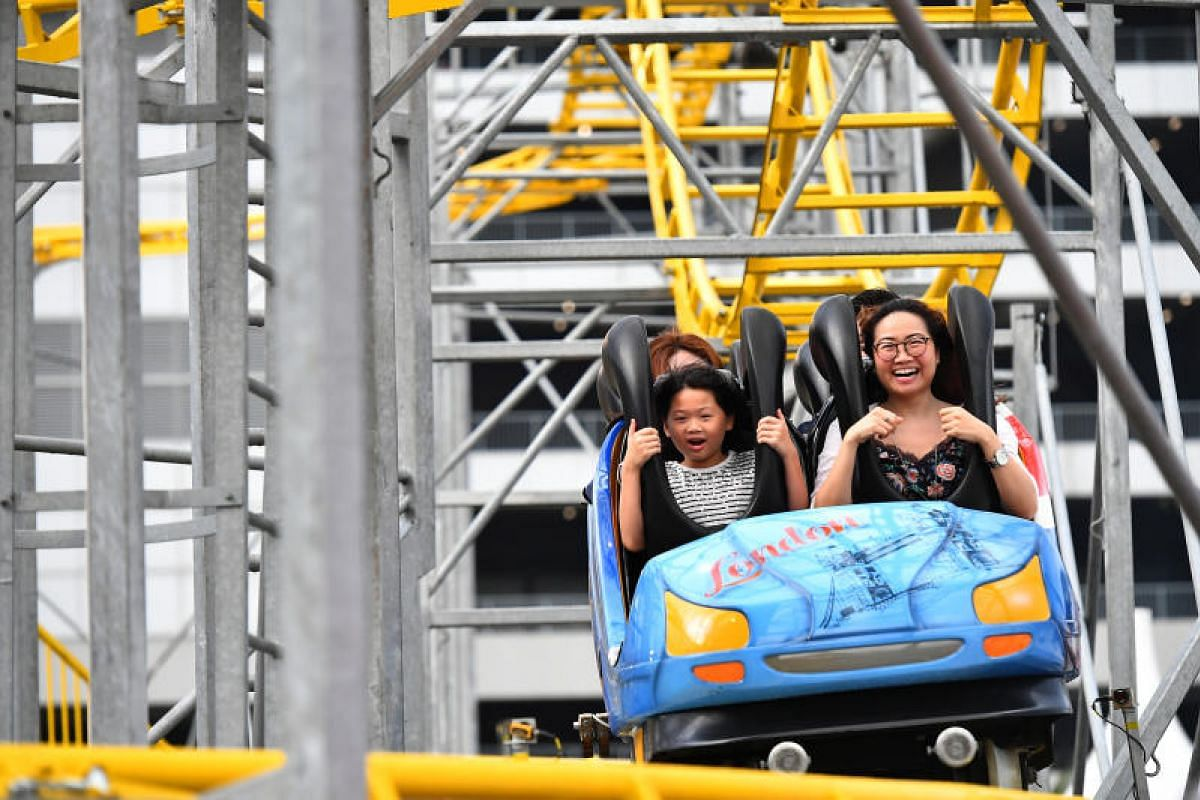 Carnival goers on the Euro Coaster on the second day of Singapore's biggest carnival - the Prudential Marina Bay Carnival, on Dec 16, 2017. It is the largest ride in the carnival spanning 700 square meters.