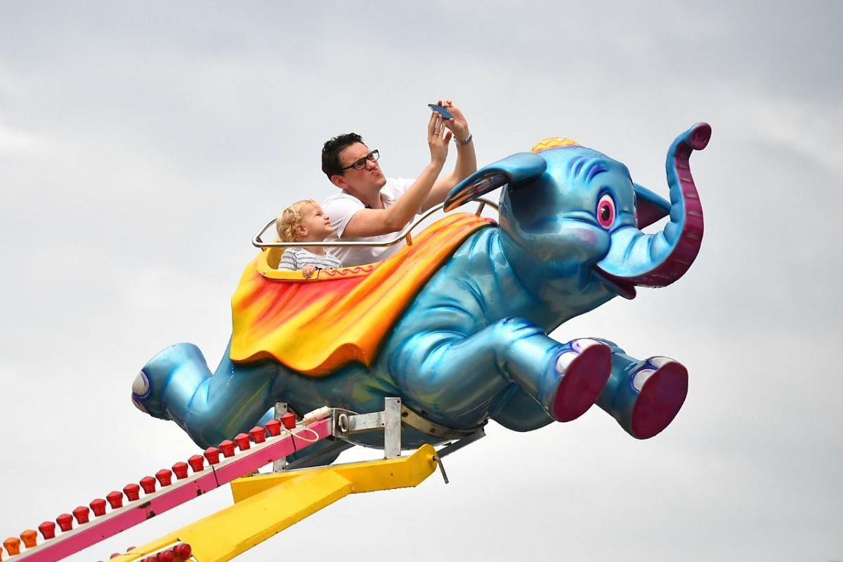 Carnival goers fly on the Dumbo Ride at the Prudential Marina Bay Carnival on Dec 16, 2017.