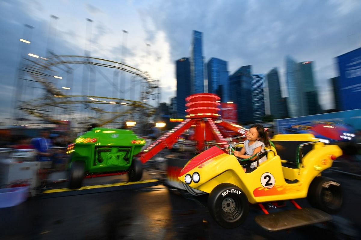 Four-year-old Fanniesha Linda enjoys herself on the Bounce and Spin ride at the Prudential Marina Bay Carnival on Dec 16, 2017.