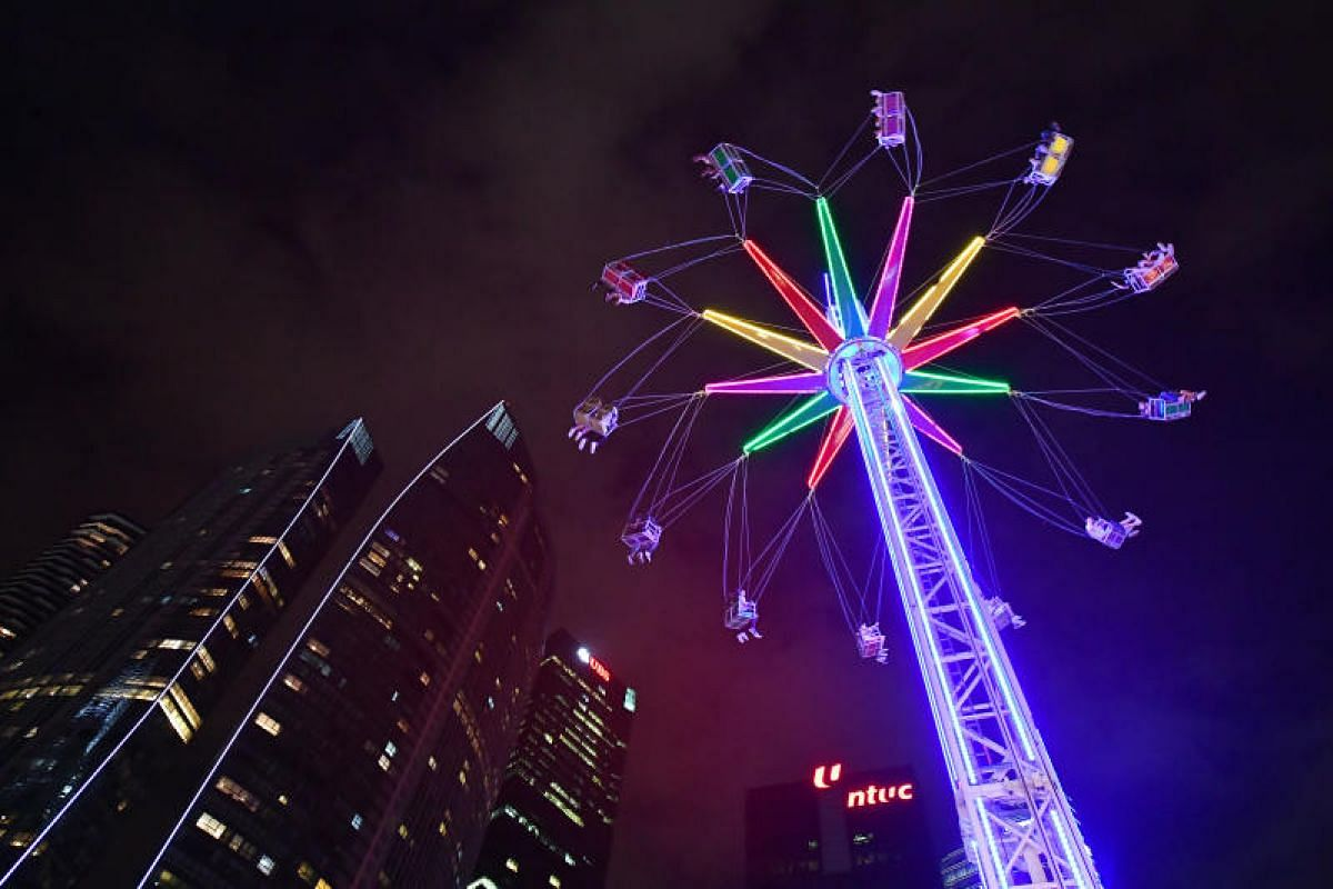 The Star Flyer, a carousel in which riders' legs dangle as they spin round and round taking in the surrounding sights, is part of 22 rides and attractions at the Prudential Marina Bay Carnival.