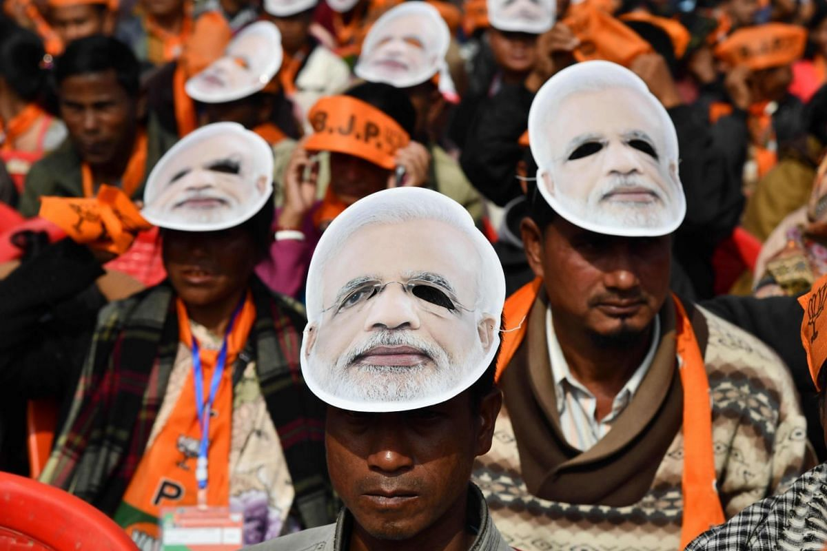 Supporters of the Bharatiya Janata Party (BJP), wearing masks of Indian Prime Minister Narendra Modi, listen to the PM during a public rally in Shillong on Dec 16, 2017. PHOTO: AFP