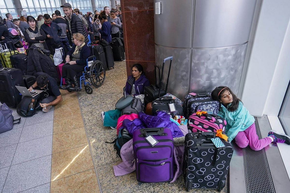 Passengers affected by a power outage wait in long lines at the International Terminal of Hartsfield-Jackson Atlanta International Airport in Georgia, on Dec 17, 2017.