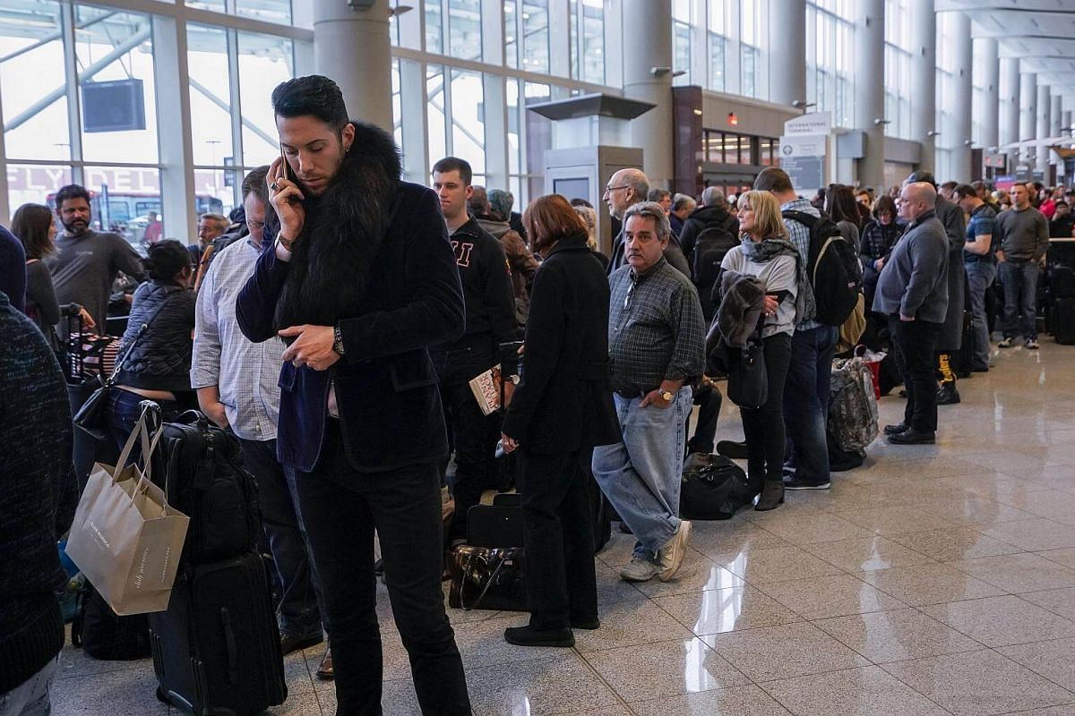 Passengers affected by a power outage wait at the International Terminal of Hartsfield-Jackson Atlanta International Airport in Georgia, on Dec 17, 2017.
