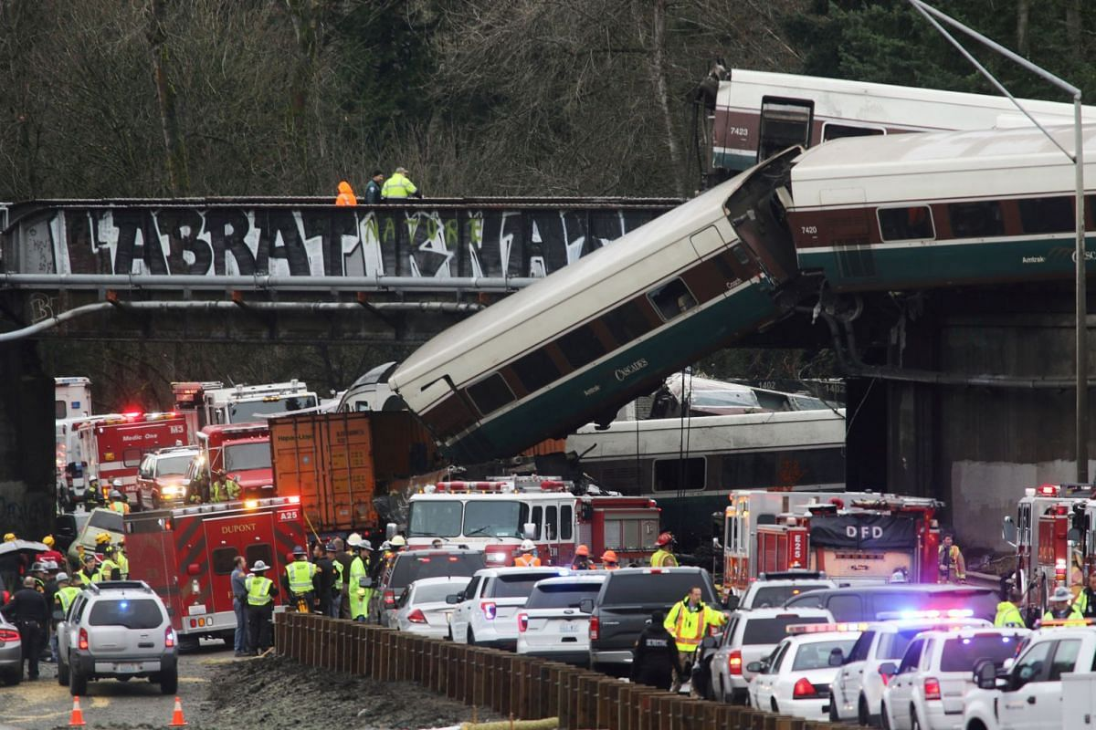 First responders are at the scene of an Amtrak passenger train which derailed and is hanging from a bridge over the interstate highway (I-5) in DuPont, Washington, US, Dec 18, 2017. PHOTO: REUTERS
