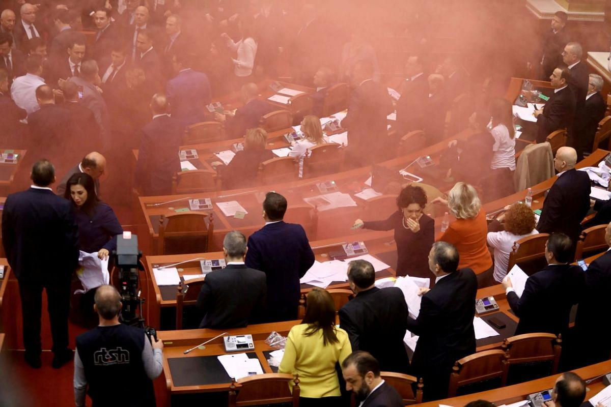 Albania's opposition lawmakers throw smoke bombs inside the Parliament during the election of the new prosecutor, in Albanian Parliament in Tirana, Albania on Dec 18, 2017. PHOTO: REUTERS
