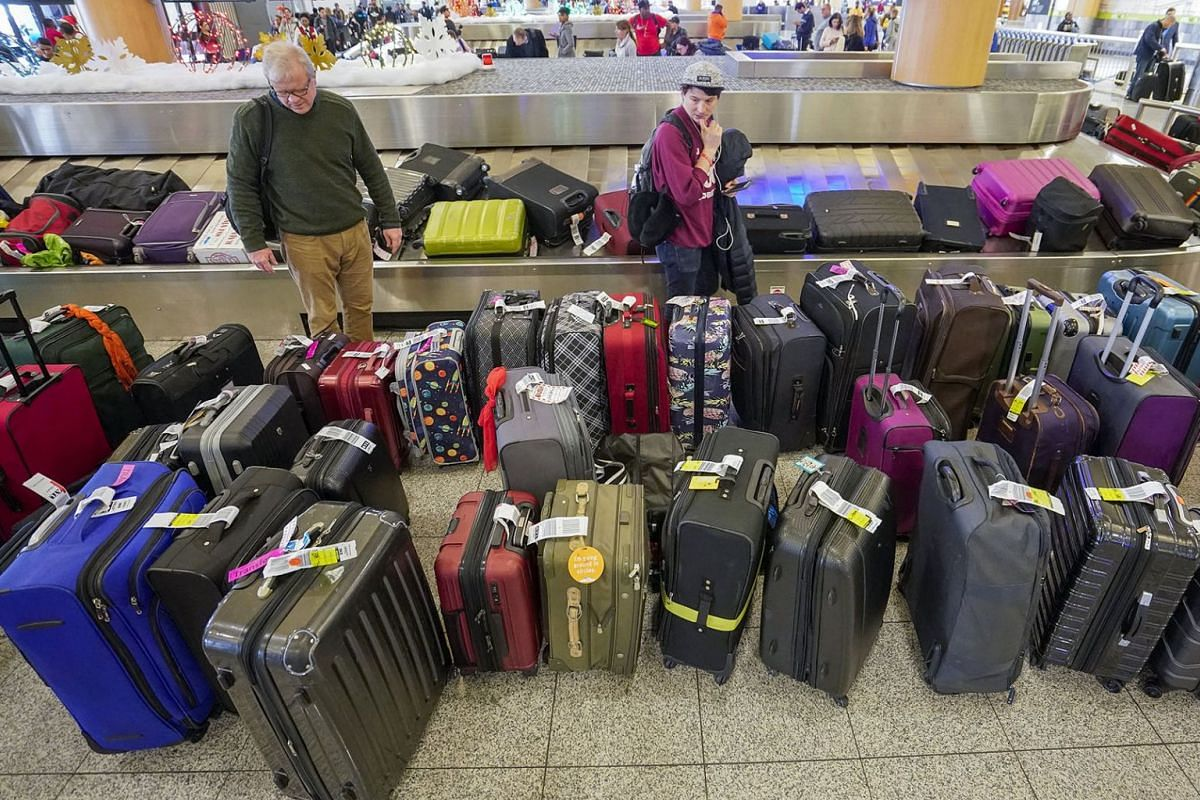Passengers affected by an 11-hour power outage search for their delayed luggage at Hartsfield-Jackson Atlanta International Airport in Atlanta, Georgia, US, on Dec 18, 2017. PHOTO:  EPA-EFE