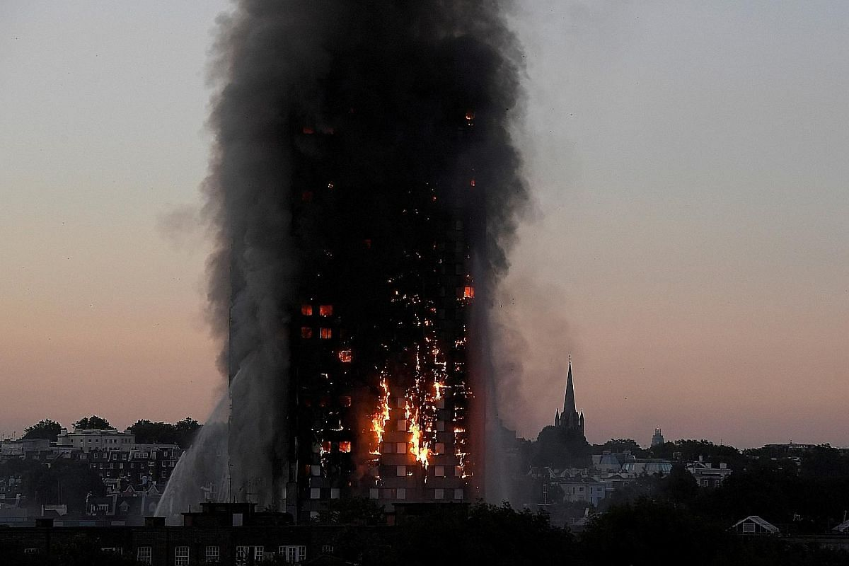 GRENFELL TOWER FIRE: Flames and smoke engulfing the Grenfell Tower apartment block in West London on June 14. The inferno spread rapidly through the 24-storey building, killing 71 people. Investigators believe flammable cladding on its exterior allow