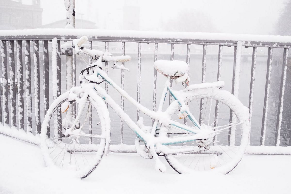 A snow covered bicycle is parked in Zurich, Switzerland, on Dec 18, 2017.