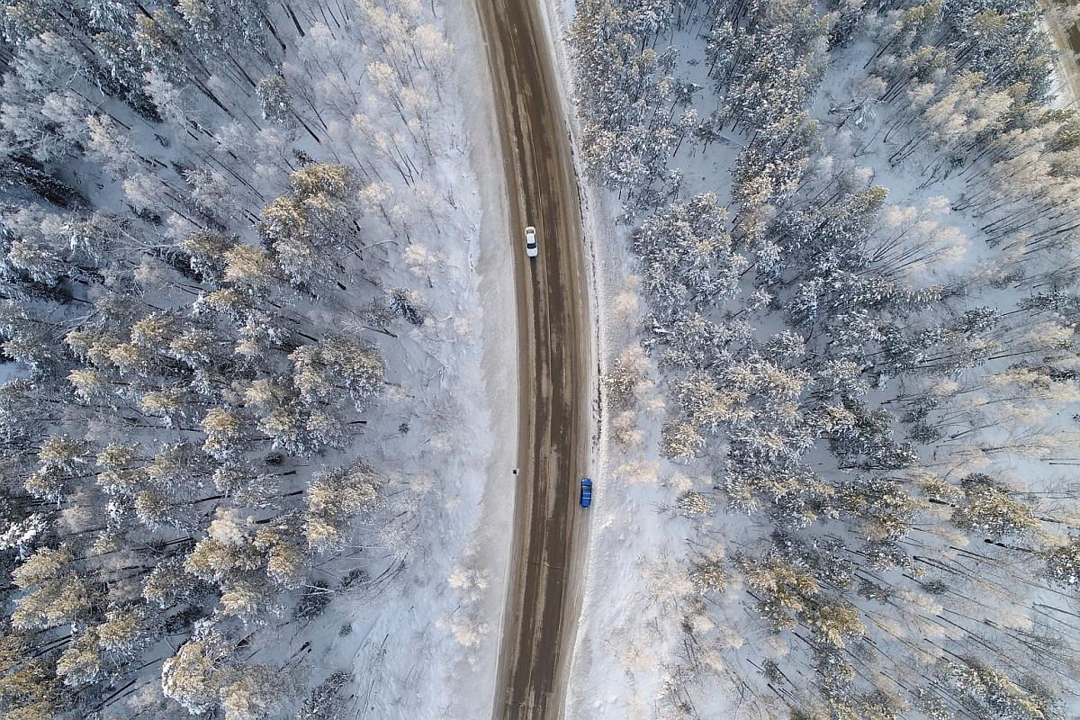 An aerial view shows a road on the banks of the Yenisei River, in air temperatures of about minus 17 deg C, outside Russia's Siberian city of Krasnoyarsk, Russia, on Dec 10, 2017.