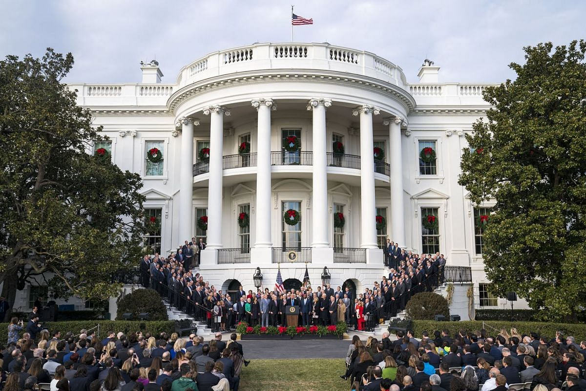 US President Donald J. Trump, joined by Republican members of the House and Senate, speaks about the passage of the Republican tax plan on the South Lawn of the White House in Washington, DC, USA December 20, 2017. PHOTO: EPA-EFE